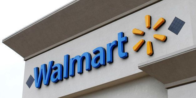 The logo of Down Jones Industrial Average stock market index listed company Walmart is shown on one of its stores in Encinita