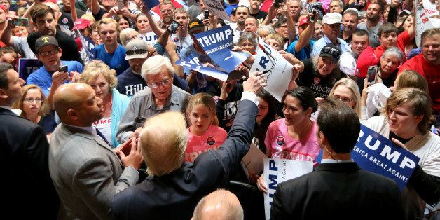 U.S. Republican presidential candidate Donald Trump signs autograph following a campaign rally in Spokane, Washington, U.S.,