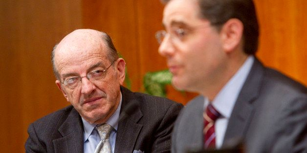 Michael Copps, commissioner of the U.S. Federal Communications Commission, left, listens to Julius Genachowski, chairman of t