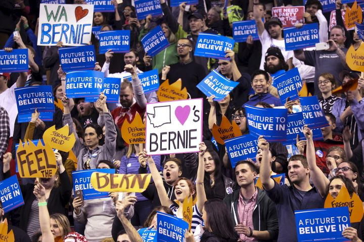 Supporters of Democratic U.S. presidential candidate Bernie Sanders cheer during a rally at Key Arena in Seattle, Washington