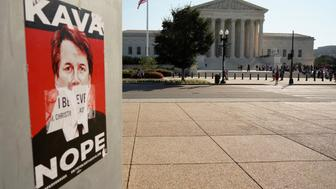 A sign against Supreme Court nominee Brett Kavanaugh is seen across from the court ahead of the first day of it's new term in Washington, U.S., October 1, 2018. REUTERS/Aaron P. Bernstein