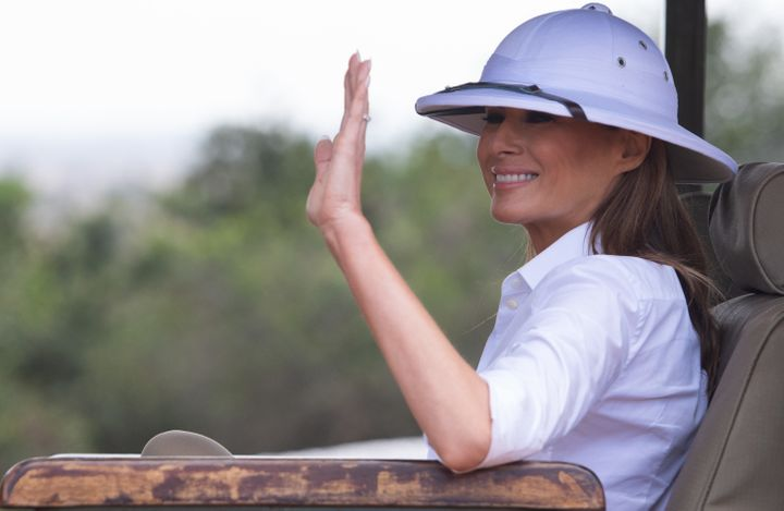 First lady Melania Trump waves as she visits Nairobi National Park on Saturday. Her decision to wear a white pith helmet drew