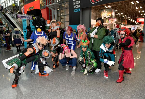"A group of fans dressed as characters from the anime ""My Hero Academia."""