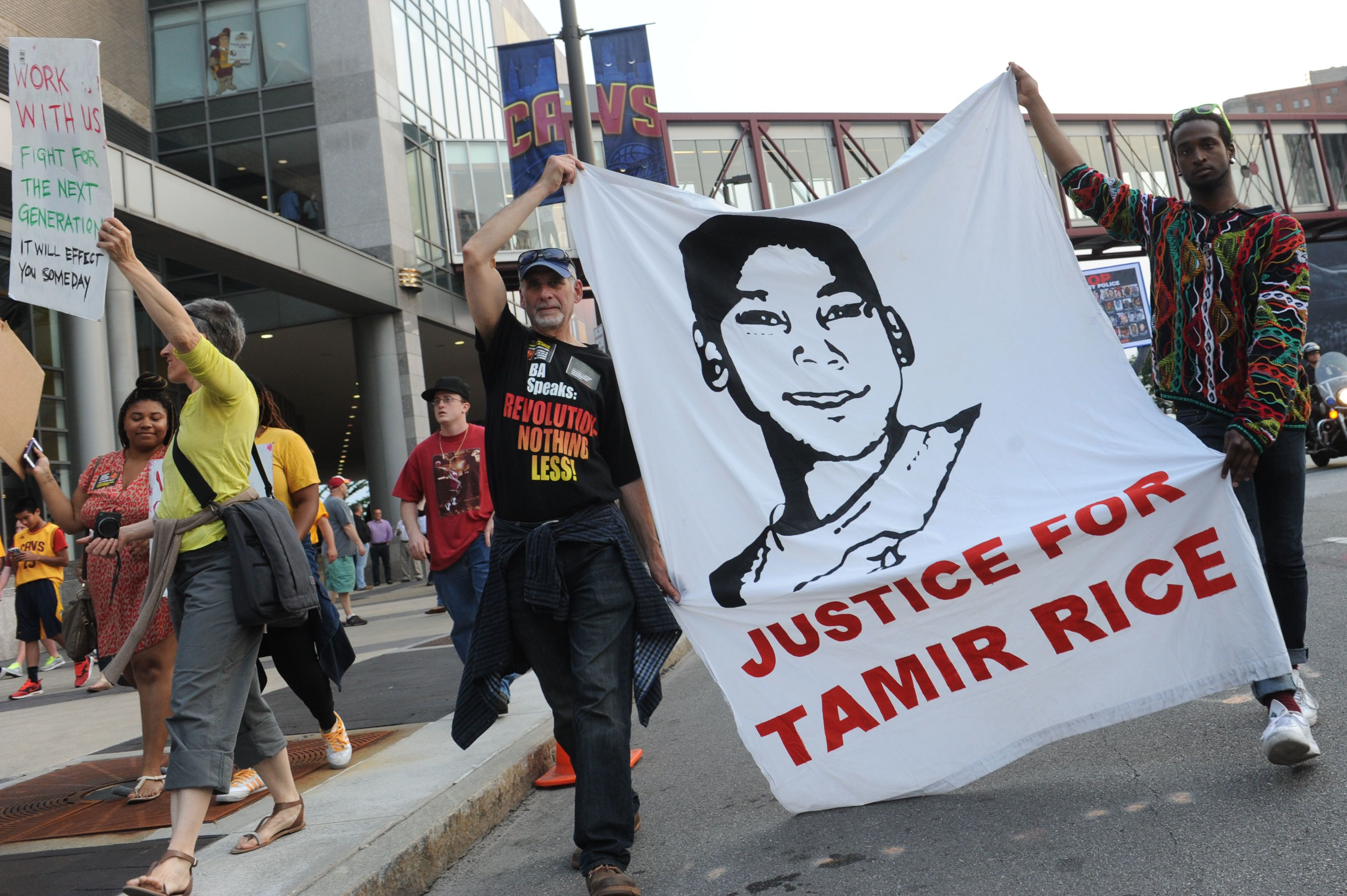 Jun 9, 2015; Cleveland, OH, USA; Tadar Muhammad (right) and Jeremy Brustein (left) demonstrate in support of Tamir Rice outside of Quicken Loans Arena prior to game three of the NBA Finals. Mandatory Credit: Ken Blaze-USA TODAY Sports