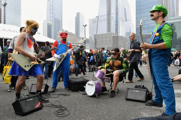 A band performs outside New York Comic Con in costume.