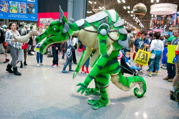 "Fan dressed as Green Lizalfos from the video game  ""Zelda: Breath Of The Wild."""