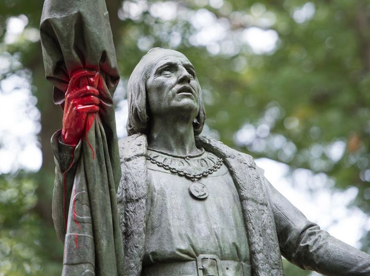 A statue of Christopher Columbus is defaced with red paint in New York City's Central Park.<i></i>