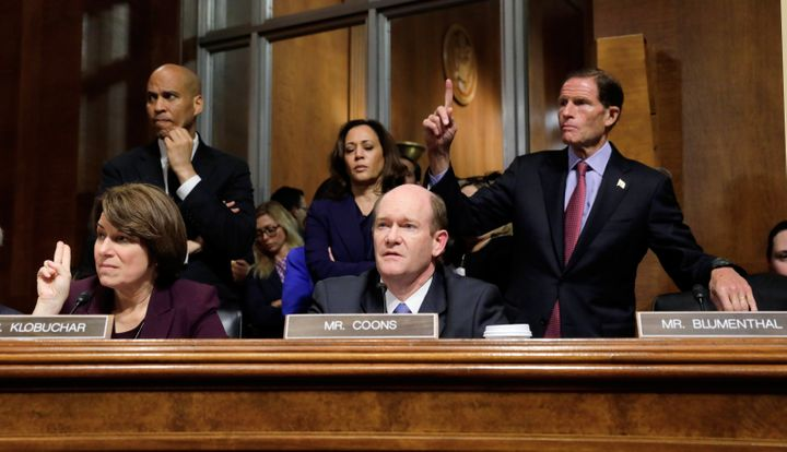 U.S. Senate Judiciary Committee Democratic member Chris Coons speaks while his colleagues Sens. Amy Klobuchar and Richard Blu