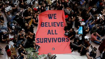 Activists rally inside the Senate Hart Office Building during a protest in opposition to U.S. Supreme Court nominee Brett Kavanaugh and in support for Christine Blasey Ford, the university professor who has accused Kavanaugh of sexual assault in 1982, on Capitol Hill in Washington, U.S., October 4, 2018. REUTERS/Kevin Lamarque     TPX IMAGES OF THE DAY