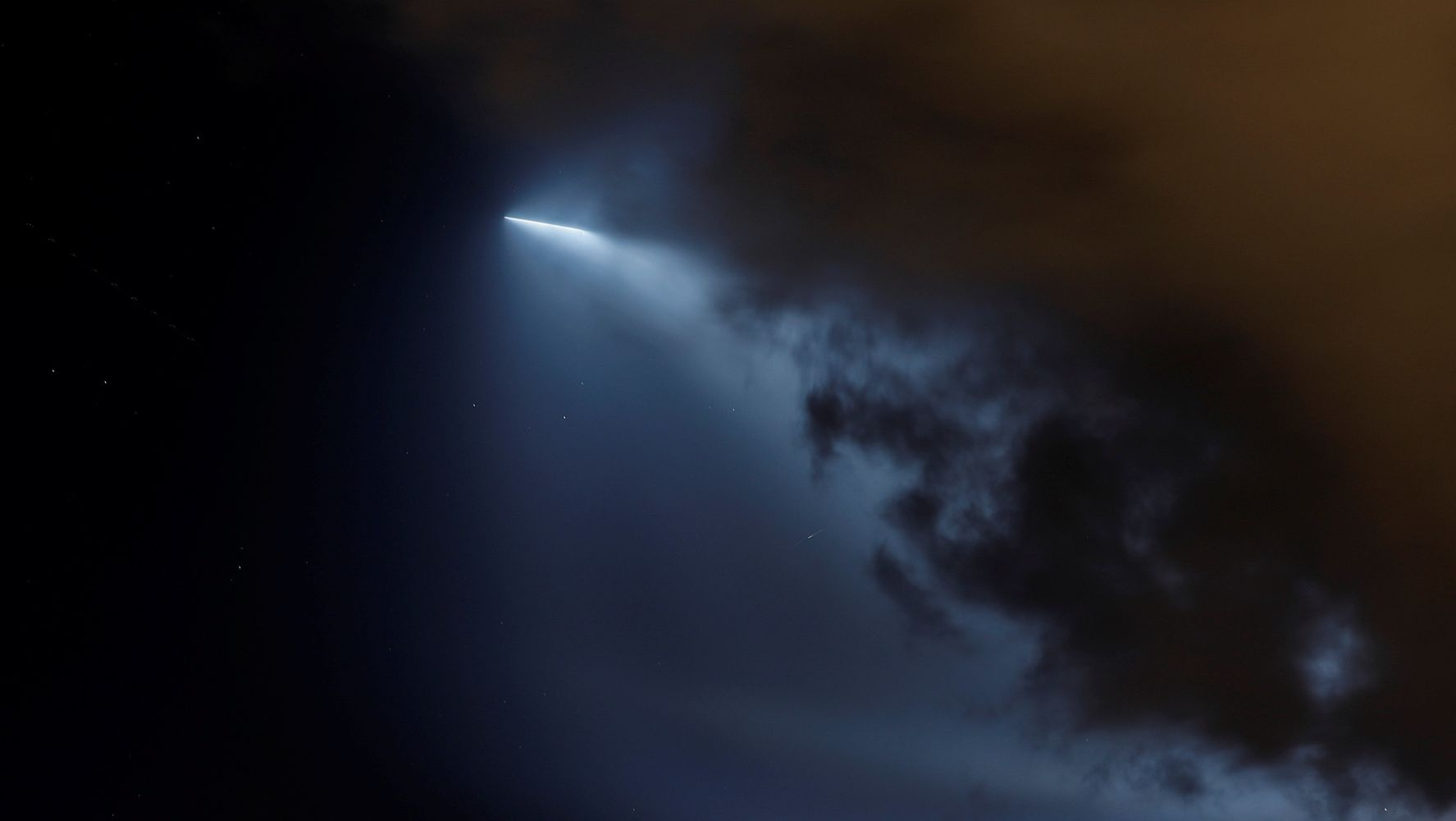 SpaceX Rocket Launch (Not Aliens) Lights Up The Night Sky Above