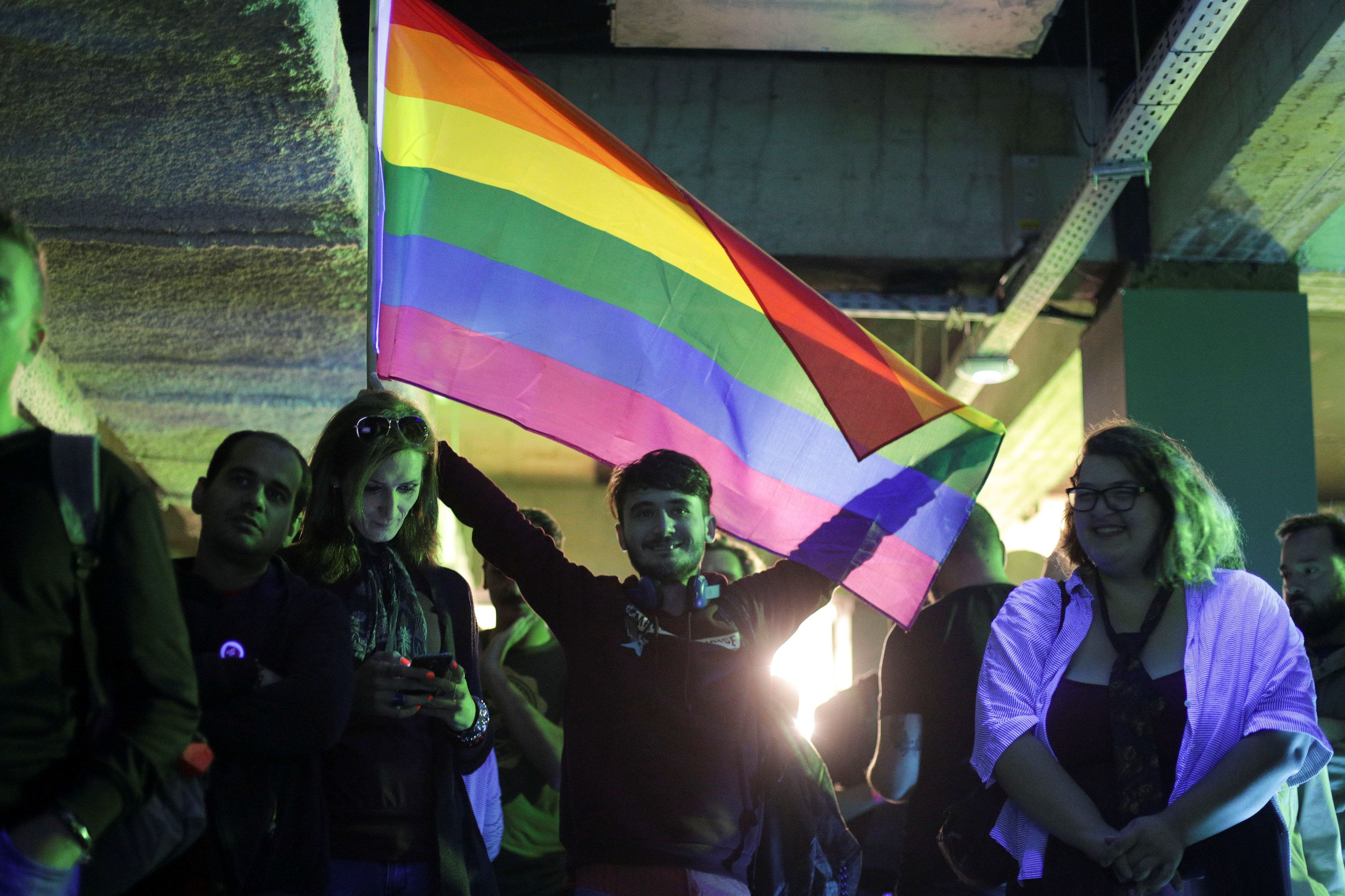 "LGBT activists react during an event organised by the LGBT rights group ""Mozaiq"" in downtown Bucharest, Romania, October 7, 2018. Inquam Photos/Octav Ganea via REUTERS ATTENTION EDITORS - THIS IMAGE WAS PROVIDED BY A THIRD PARTY. ROMANIA OUT."