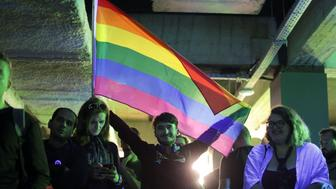 """LGBT activists react during an event organised by the LGBT rights group """"Mozaiq"""" in downtown Bucharest, Romania, October 7, 2018. Inquam Photos/Octav Ganea via REUTERS ATTENTION EDITORS - THIS IMAGE WAS PROVIDED BY A THIRD PARTY. ROMANIA OUT."""