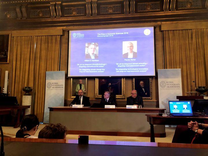 William Nordhaus, left on screen, andPaul Romer share the 2018 Nobel Memorial Prize in Economic Sciences.