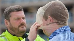 Police Welcome Use Of 'Cruel And Degrading' Spit Guards On