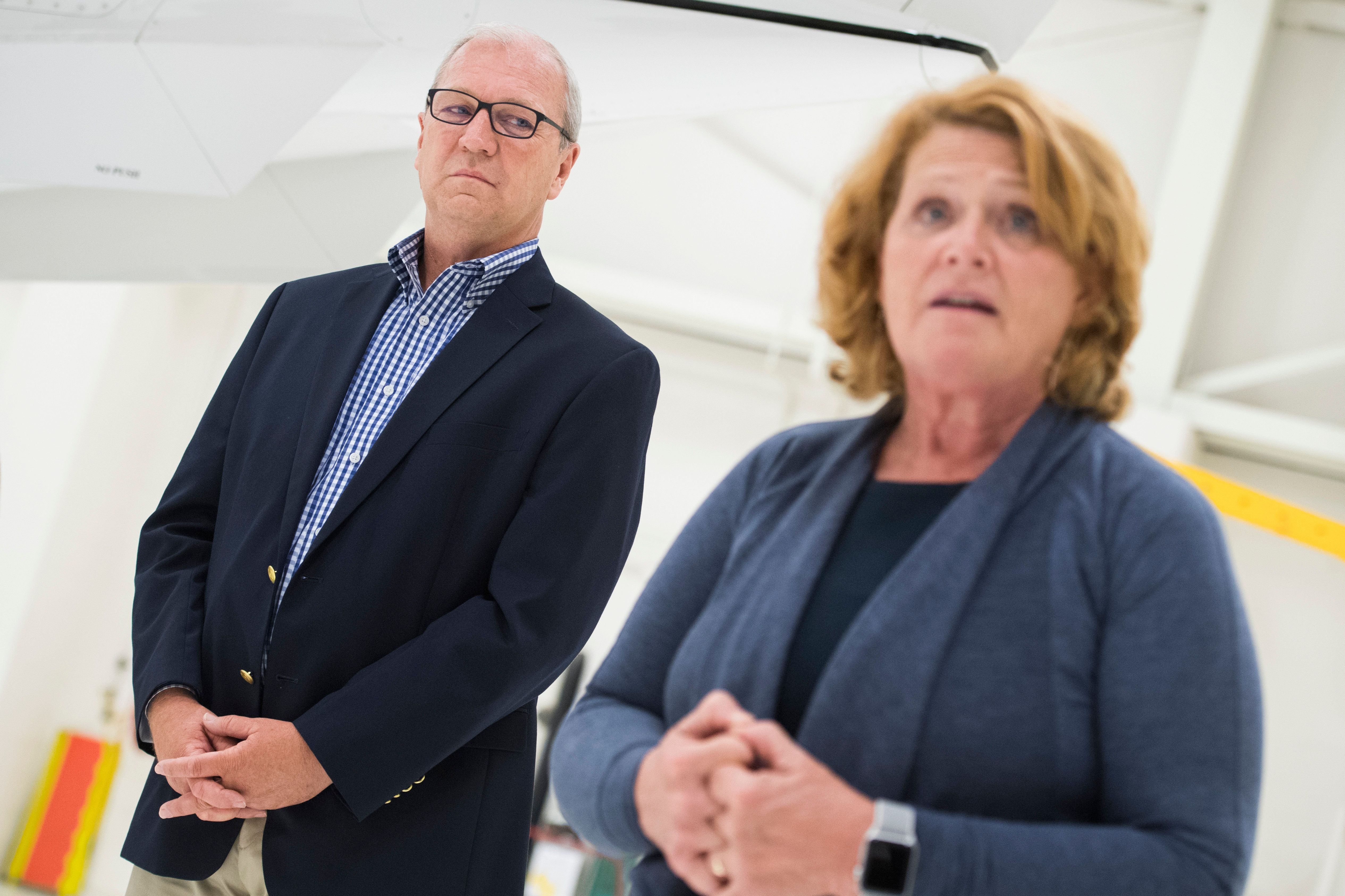 UNITED STATES - AUGUST 17: Sen. Heidi Heitkamp, D-N.D., and Rep. Kevin Cramer, R-N.D., attend an event with National Guardsmen in Bismarck, N.D., on August 17, 2018, before some troops were deployed to Africa. They are running against each other for the North Dakota Senate seat. (Photo By Tom Williams/CQ Roll Call)