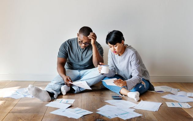 You can buy a house while you're in debt. Whether that's a good idea depends on a few crucial