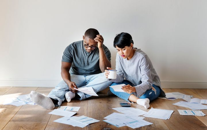 You can buy a house while you're in debt. Whether that's a good idea depends on a few crucial factors.