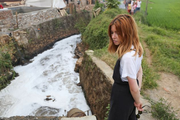 Dooley stands by the pollutedCitarum River in Indonesia.
