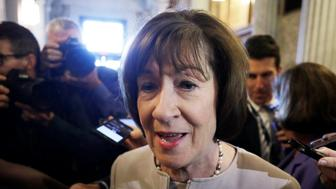U.S. Senator Susan Collins (R-ME) talks with reporters as she leaves the floor of the Senate after announcing that she will vote to confirm Supreme Court nominee judge Brett Kavanaugh in a speech on Capitol Hill in Washington, U.S., October 5, 2018. REUTERS/Yuri Gripas