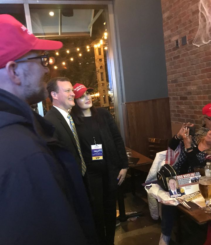 Laura Loomer (center) poses with Jeff Johnson, the Republican nominee for governor of Minnesota, at a party hosted by Doug Wa