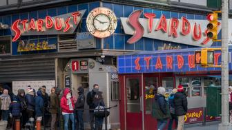 Tourists line up in the cold to enter Ellen's Stardust Diner on Sunday, January 14, 2018. The Times Square attraction boasts singing waitpersons to amuse diners.(�Photo by Richard B. Levine)