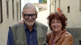 LUCCA, ITALY - APRIL 07:  American film Director, screen writer and editor George Romero (L) leaves with his wife Suzanne Romero after attending a press conference and interviews during the Lucca Film Festival 2016 on April 7, 2016 in Lucca, Italy.  (Photo by Laura Lezza/Getty Images)