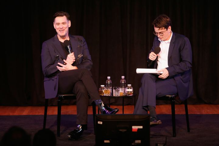 Jim Carrey (left) speaks with The New Yorker's Colin Stokes during the magazine's annual arts and ideas festival, in New York