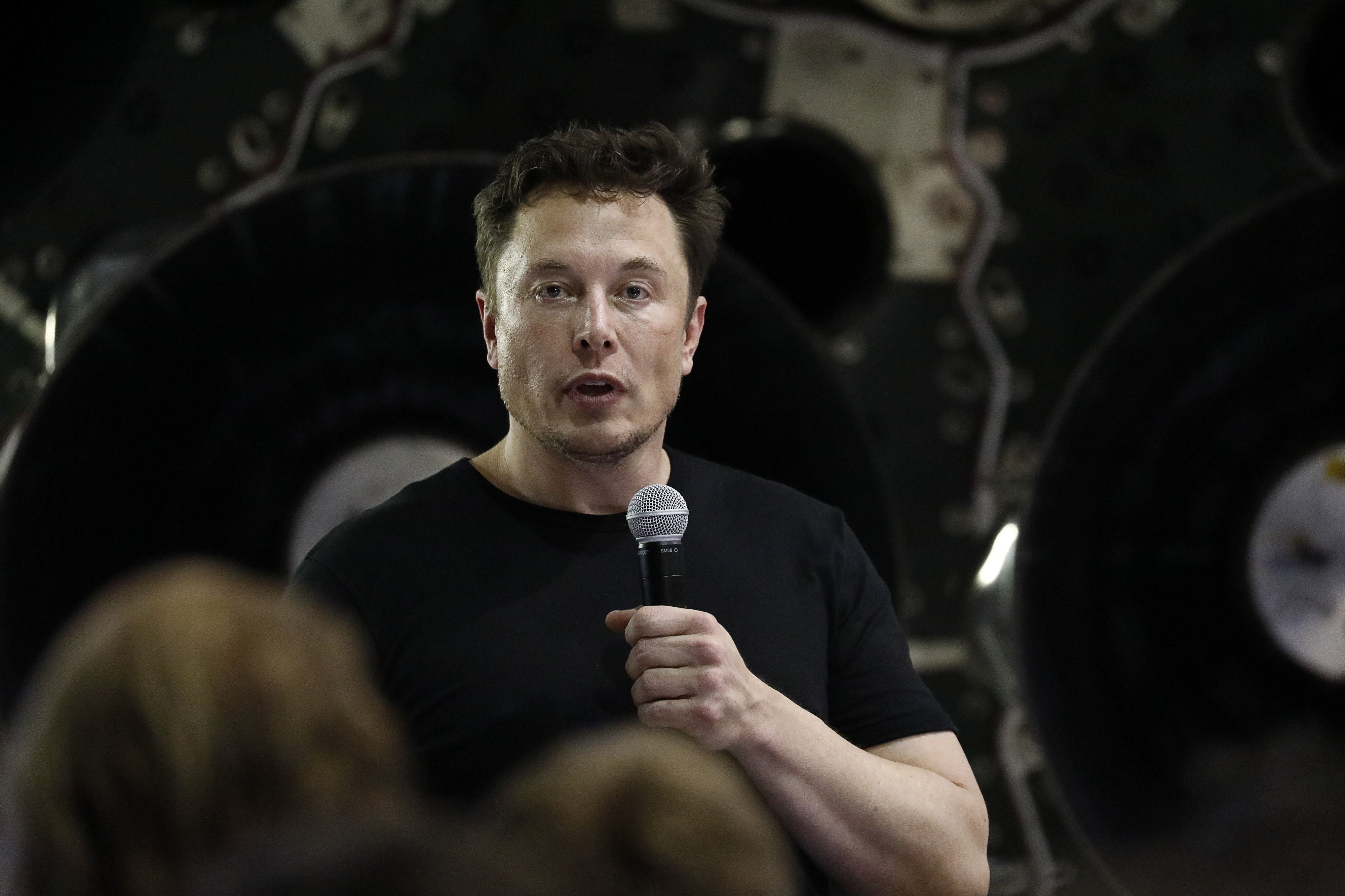Elon Musk, chief executive officer for Space Exploration Technologies Corp. (SpaceX), speaks during an event at the SpaceX headquarters in Hawthorne, California, U.S., on Monday, Sept. 17, 2018. Musk just revealed the identity of the precious cargo hitching a ride around the moon with his rocket company: Japanese billionaire Yusaku Maezawa. Photographer: Patrick T. Fallon/Bloomberg via Getty Images