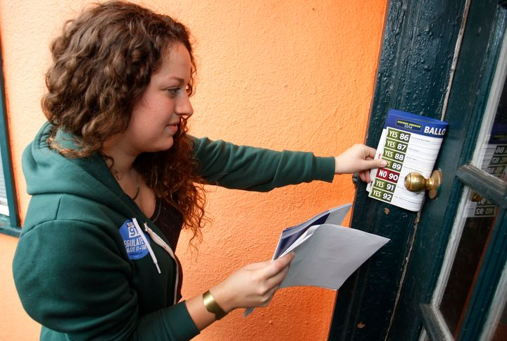 Canvasser in Oregon leaves a flyer at a door to drum up support for Measure 91 in 2014. It passed, legalizing marij