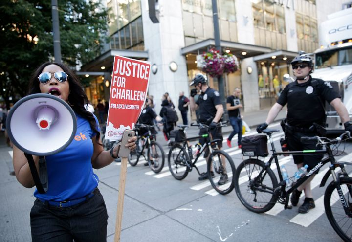 A marcher in Seattle, June 22, 2017, protesting the fatal police shooting of Charleena Lyles that month. Washington voters wi