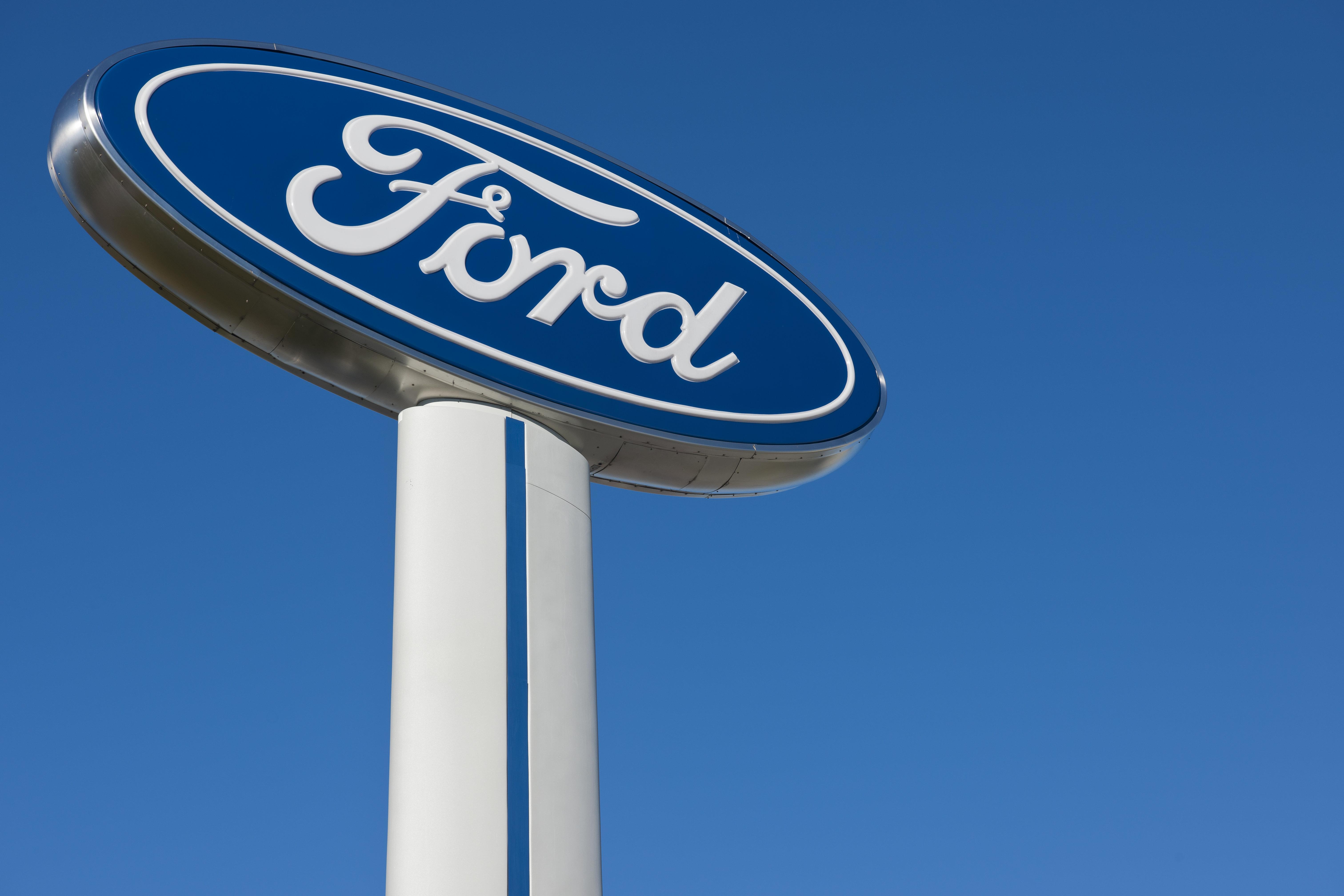 Ford Plans Layoffs After $1 Billion Trump Tariff