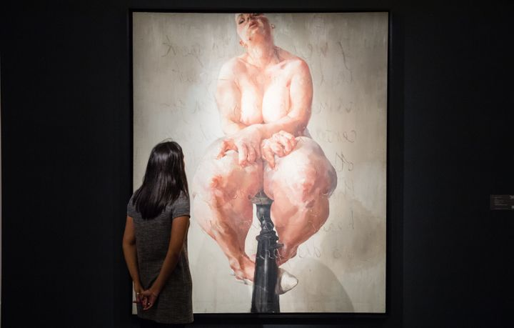 "A viewer looking at ""Propped"" by Jenny Saville at the press preview for Sotheby's Freize week exhibition of contemporary art."