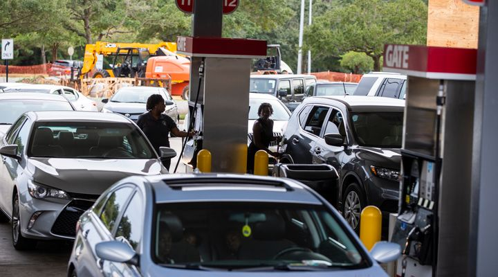 Drivers line up for gasoline as Hurricane Michael bears down on the northern Gulf coast of Florida.
