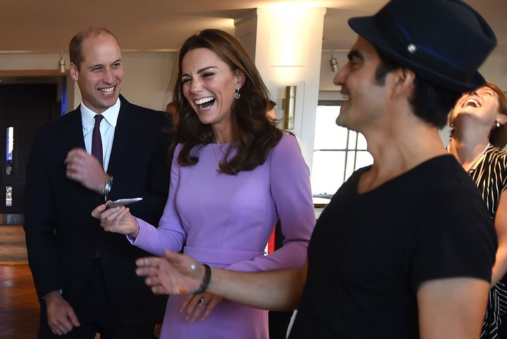 Prince William and Duchess Kate react as they paint with Columbian artist Dairo Vargas on Oct. 9.