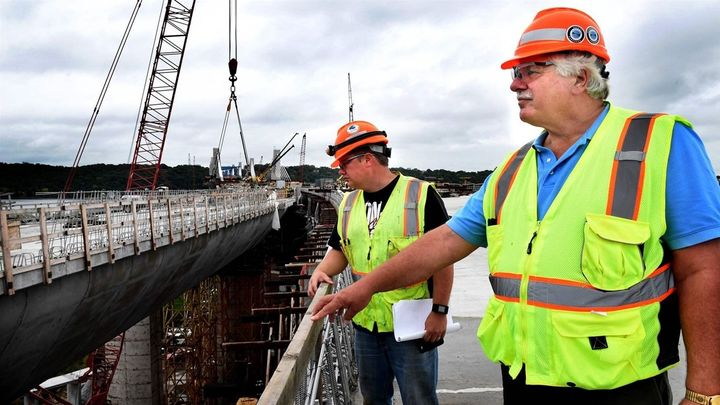 Terry Zoller, right, a Minnesota Department of Transportation bridge construction manager, and inspector Josh Hebert examine