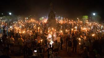 Neo Nazis, Alt-Right, and White Supremacists encircle counter protestors at the base of a statue of Thomas Jefferson after marching through the University of Virginia campus with torches in Charlottesville, Va., USA on August 11, 2017. (Photo by Zach D Roberts/NurPhoto via Getty Images)
