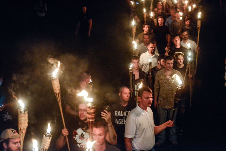 White supremacists participate in a torch-lit march on the University of Virginia campus ahead of the Unite the Right Rally i