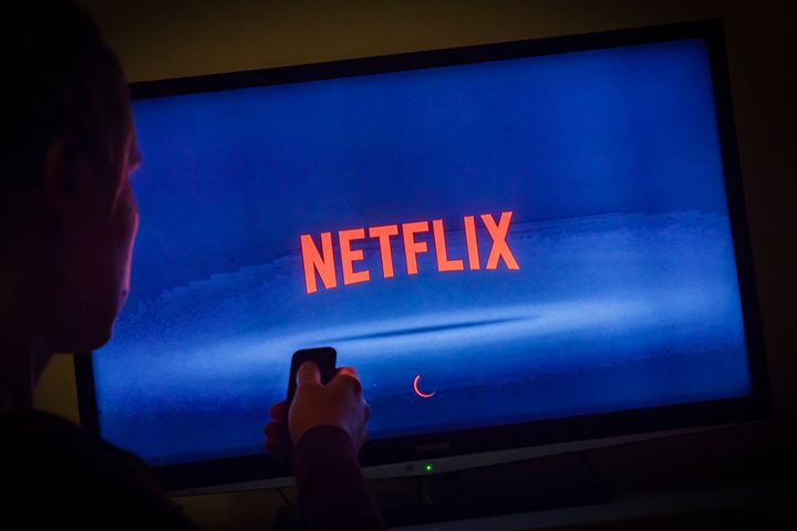 Netflix looking spooky in a dark room.