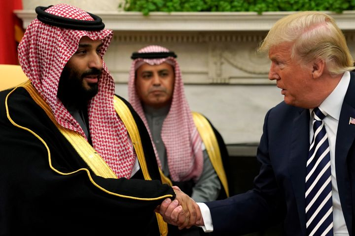 U.S. President Donald Trump shakes hands with Saudi Arabia's Crown Prince Mohammed bin Salman in the Oval Office on March 20,