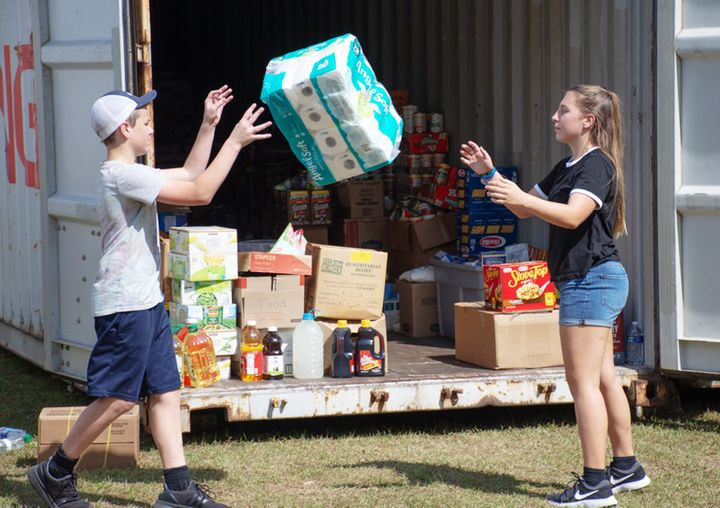 Volunteers help sort incoming donations for families affected by Hurricane Florence in Hampstead.