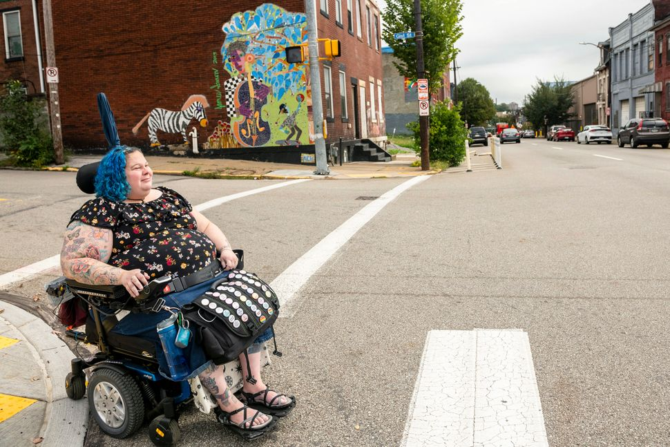 To cross streets, Grishman has to use crosswalks where there is an incline for her wheelchair.<i></i><i></i>