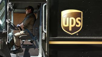 SANTA FE, NEW MEXICO - AUGUST 1, 2018:  A UPS (United Parcel Service) truck driver makes a delivery in Santa Fe, New Mexico. (Photo by Robert Alexander/Getty Images)