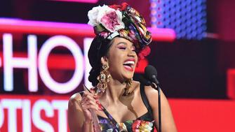 LOS ANGELES, CA - OCTOBER 09:  Cardi B accepts the Favorite Artist - Rap/Hip-Hop award onstage during the 2018 American Music Awards at Microsoft Theater on October 9, 2018 in Los Angeles, California.  (Photo by Jeff Kravitz/AMA2018/FilmMagic For dcp ,)