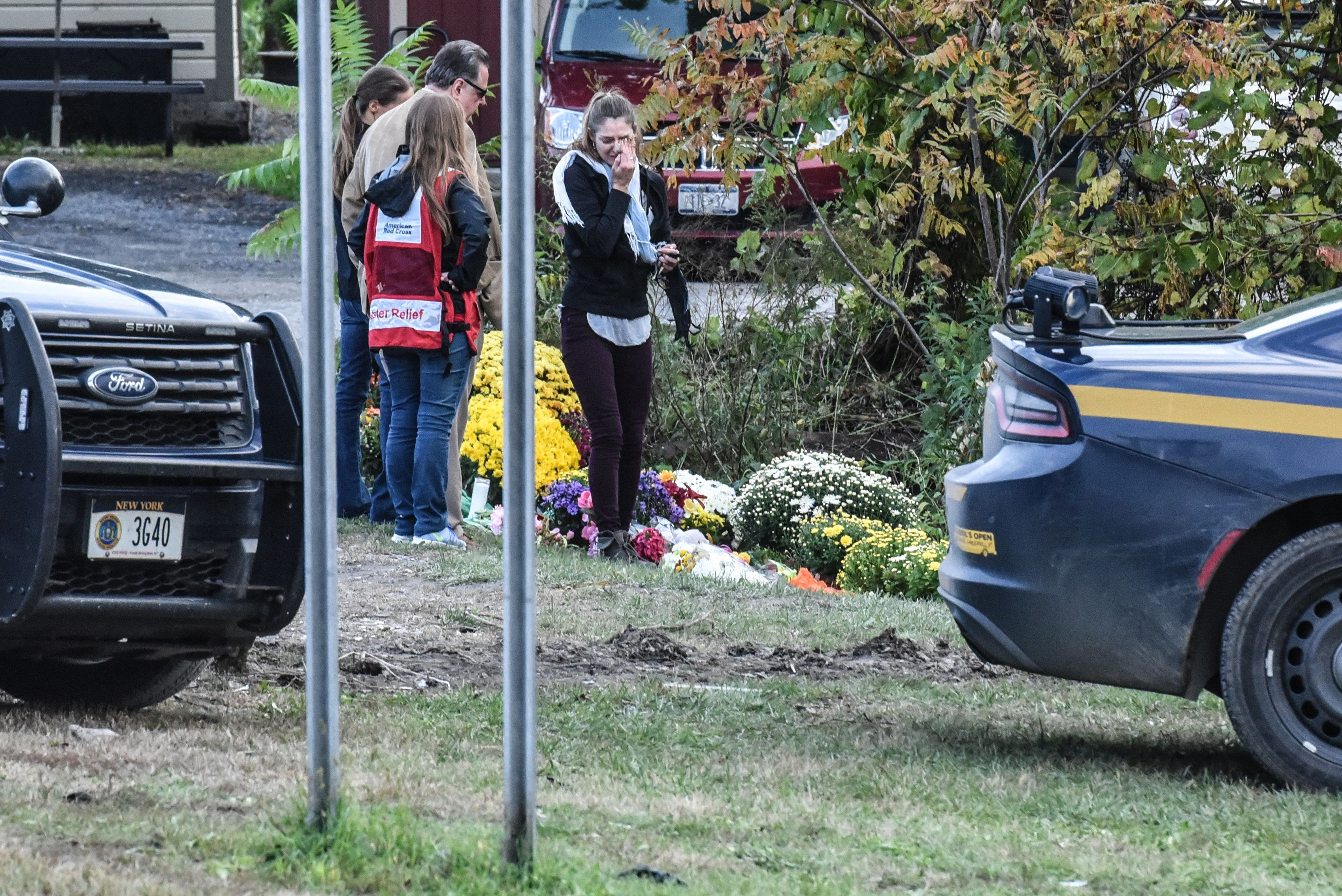 SCOHARIE, NY - OCTOBER 08: People mourn at the site of the fatal limousine crash on October 8, 2018 in Schoharie, New York. 20 people died in the crash including the driver of the limo, 17 passengers, and two pedestrians. (Photo by Stephanie Keith/Getty Images)