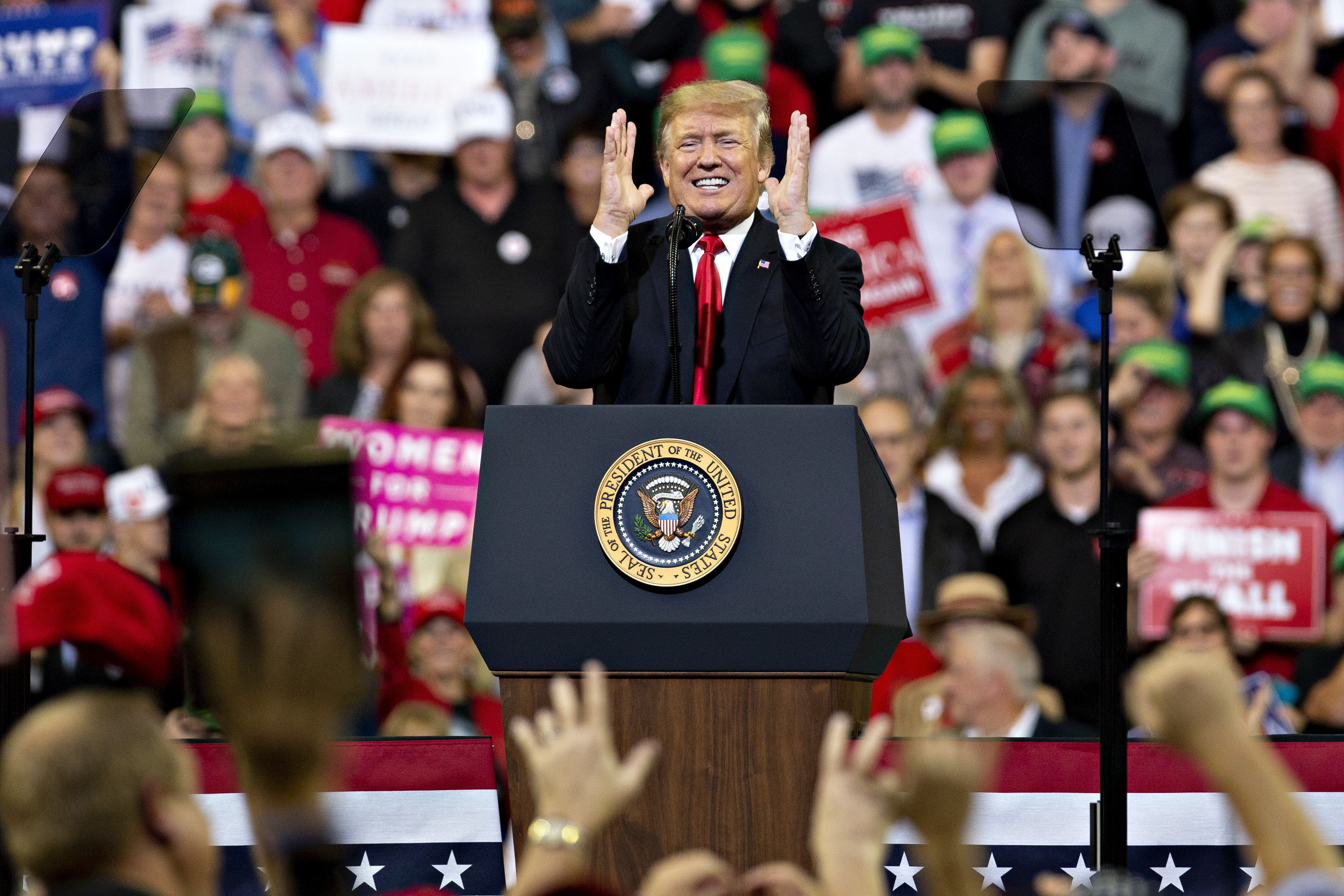 U.S. President Donald Trump gestures as he speaks at a rally in Council Bluffs, Iowa, U.S., on Tuesday, Oct. 9, 2018. Trump said he is considering Goldman Sachs Group Inc.'s Dina Powell to replace his departing ambassador to the United Nations, Nikki Haley. Photographer: Daniel Acker/Bloomberg via Getty Images