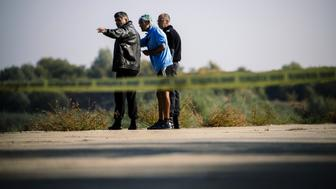 Policemen talk with a man on October 9, 2018, near the site where Bulgarian television journalist Viktoria Marinova was killed on October 6, in the city of Rousse. - Corruption-plagued EU member Bulgaria found itself under pressure to find the killer of a television journalist whose brutal murder at the weekend has shocked the country and sparked international condemnation. The body of 30-year-old Viktoria Marinova -- who presented a current affairs talk programme called 'Detector' for the small private TVN television in Ruse -- was found on October 6, 2018. (Photo by Dimitar DILKOFF / AFP)        (Photo credit should read DIMITAR DILKOFF/AFP/Getty Images)