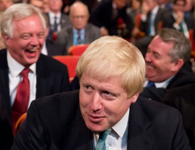 David Davis, Boris Johnson and Liam Fox have a laugh in the audience at the Conservative party conference...