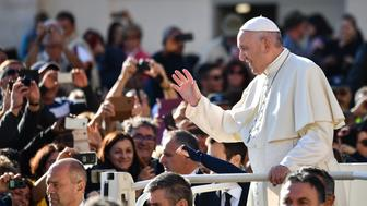 Pope Francis gestures towards the faithful as he arrives in the popemobile car for the weekly general audience at St.Peter's square in the Vatican on October 10, 2018. (Photo by Alberto PIZZOLI / AFP)        (Photo credit should read ALBERTO PIZZOLI/AFP/Getty Images)