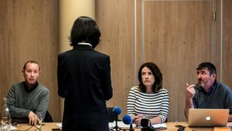 Grace, the wife of the missing Interpol president Meng Hongwey, talks to journalists on October 7, 2018 in Lyon during a press conference during which she did not want her face to be shown, a day after Interpol demanded an official 'clarification' from China on the whereabouts of its missing police chief, after reports said he was detained for questioning on arrival in his homeland. - Beijing has remained silent over the mysterious disappearance of Meng Hongwei, who was last seen leaving for China in late September from the Interpol headquarters in Lyon, southeast France, a source close to the enquiry told AFP. (Photo by JEFF PACHOUD / AFP)        (Photo credit should read JEFF PACHOUD/AFP/Getty Images)