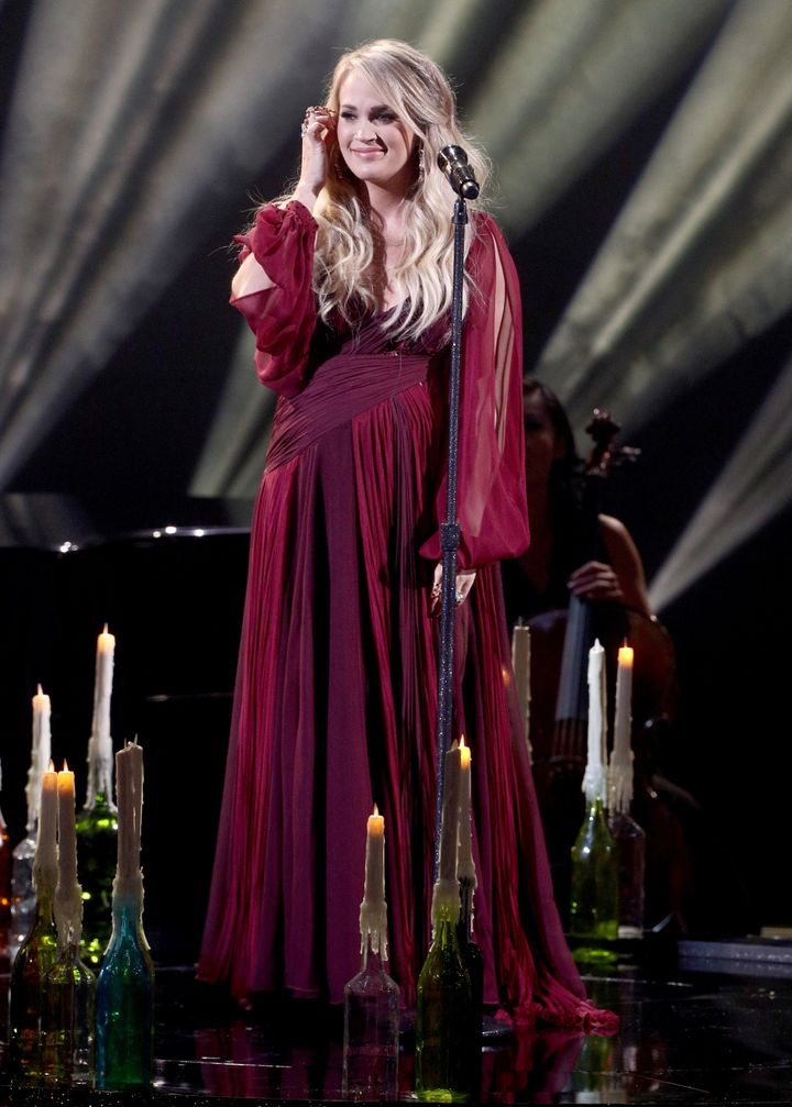 The country singer changed into a long, flowing red gown for the performance.